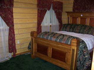 Houston cabin photo - Master bedroom with queen bed, luxurious linens, and LCD TV.