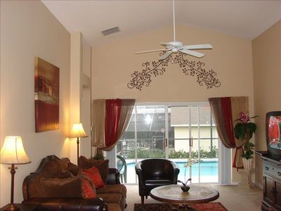 Very comfortable living room that over looks the pool area.  Great for families!