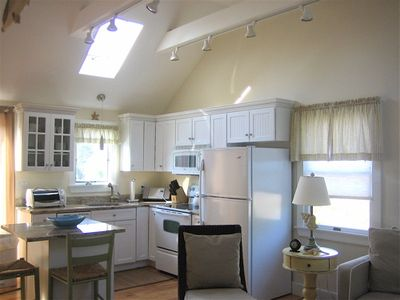 The sunny, fully equipped kitchen w/ Air Conditioning and ceiling fans.