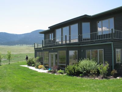 Huge bay windows offer unobstructed views of the mountains.