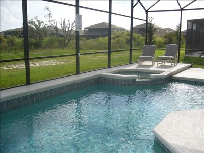 Pools & Spa overlooking natural wetland,