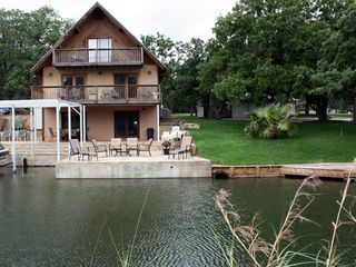 1st home has 3 levels on water's edge, including 1100sf stone patio