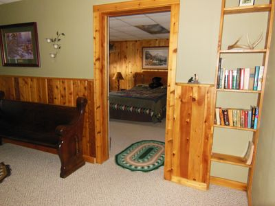 Beautiful cedar wainscoting and trim accent the Cedar Unit living room.