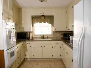 Waco house photo - The kitchen is furnished with pots & pans & basic cooking utensils. Dishes for 8
