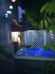 Ocean Park apartment photo - Our jacuzzi at night. A tropical paradise.