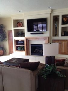Luxerious Main Floor Family Room. Huge TV and top of the line electronics.