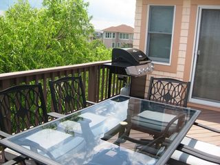 Corolla house photo - Gas grill on upper deck