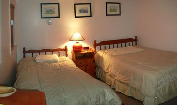 Bedroom: one double bed, and one twin bed. Located on second floor.