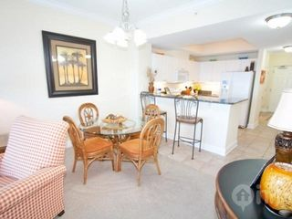 Gulf Shores condo photo - Dining area with seating for four and two bar stools
