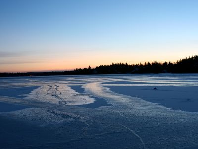 Ice covered lake; still and quiet.