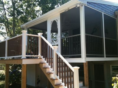 New Screen Porch w/ deck area and walk down to backyard.