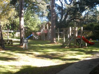 St. Simons Island condo photo - Large shaded playground for the little guys