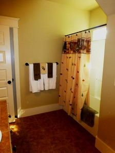 1 of 4 Bathrooms with Walk in Closet and Tile Throughout.