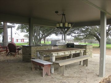Outdoor Kitchen with stainless charcoal grill and gas griddle.