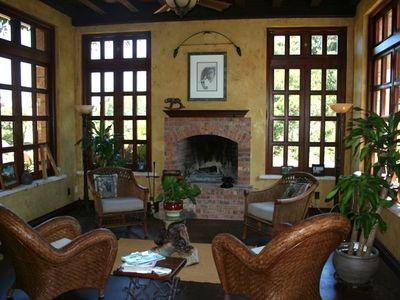 This sitting room has a wood burning fireplace and views of Bishop's Peak.