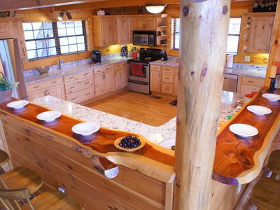 Granite counter tops and beautiful large natural cedar wood bar that seats 6.