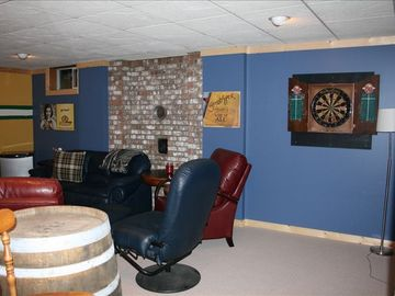 Darts and barstools to enjoy the games room, you can also run outside to the tub