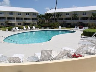 Grand Cayman condo photo - Take a break from the beach and swim in our large, heated pool