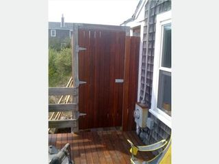 East Sandwich house photo - Outdoor enclosed shower with mahogony decking
