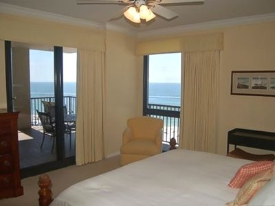 Master bedroom with access to balcony and window facing the ocean