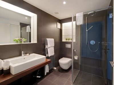 Third bathroom with overhead shower