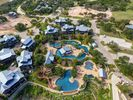 The Reserve at Lake Travis - The Reserve at Lake Travis is home to luxurious amenities like a large shared pool with a lazy river and waterslide.