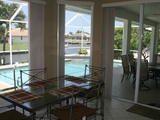Vacation Homes in Marco Island house photo - Breakfast nook overlooks pool and lagoon.