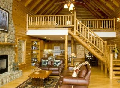 Living area with handcrafted log staircase