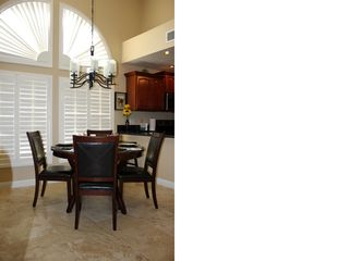 Chandler condo photo - Plantation shutters over cherry and leather dining room