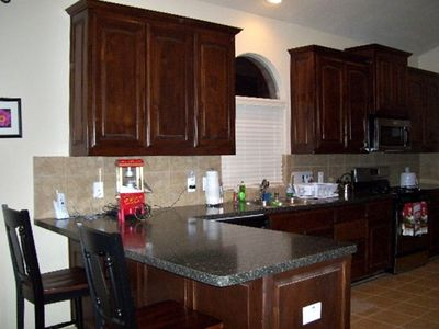 Large Kitchen with tiled backsplash and beautiful counters