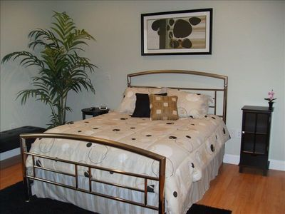 Lovely Contemporary Bedroom Suite w/ Queen Bed, Desk. and of course, it's own TV