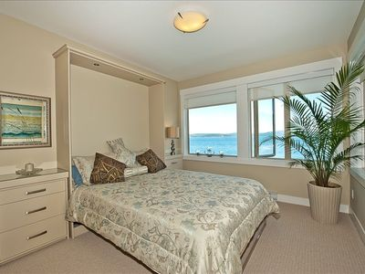 Master bedroom  has spectacular sunrises over the ocean.