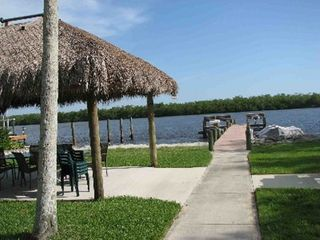Fort Myers Beach cottage photo - Fishing dock, large tiki hut and slips for your boat! Guaranteed to catch a fish