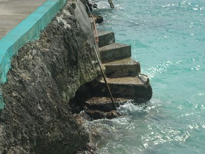 Solid concrete steps into the ocean.