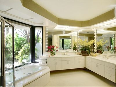 Master bath overlooking private garden has Jacuzzi tub and separate shower