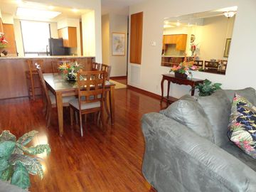 Large living and dining areas with Brazilian Hickory flooring throughout