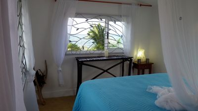 Amazing upstairs bedroom with queen bed and unbelievable breezes and view!