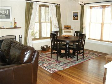 Santa Fe house rental - Bright, Living and Dinning area with Walnut Floors & Plaster Walls