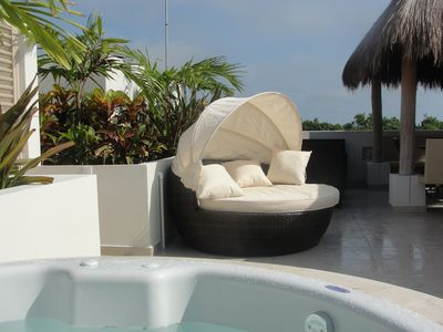 Private rooftop with jacuzzi and gazebo