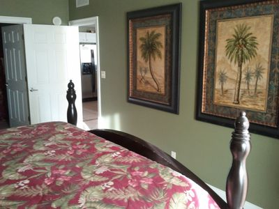 Master bedroom with beautiful oil paintings and private master bath