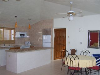 Cabo San Lucas condo photo - Open spacious kitchen and dining area, just a step out to the private back patio