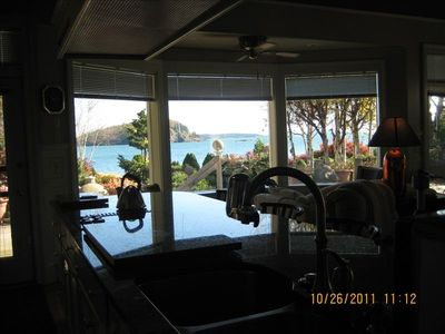 Bar Harbor estate rental - Kitchen has lg granite bar, fireplace, sofa, recliners, TV, A/C & table for six!