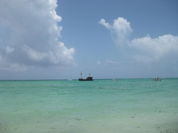 Pirate boat anchored off our beach