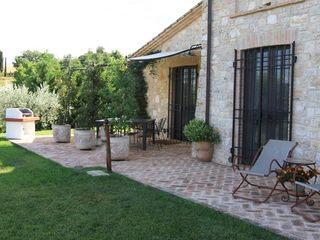 Collazzone farmhouse photo - View of backyard dining area, barbecue