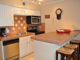 New Braunfels condo photo - Additional counter space and cabinets make it easier to actually cook in this un