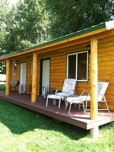 Cabin with 2 bedrooms, approx 18x18. Both share bath & outdoor kitchen