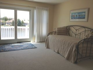 Manistee condo photo - Upper level living/sleeping area with porch