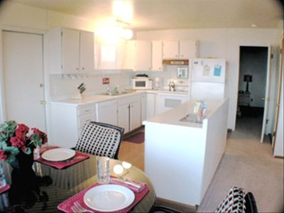 FULLY EQUPPED KITCHEN AREA. ALSO AVAILABLE IS A CARD TABLE AND MORE CHAIRS.