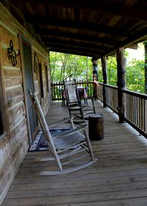 Large front porch. 2 rocking chairs and an outdoor eating area.
