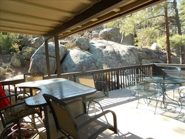 The Artist's Loft's private deck & patio nestled in the boulders and pines.